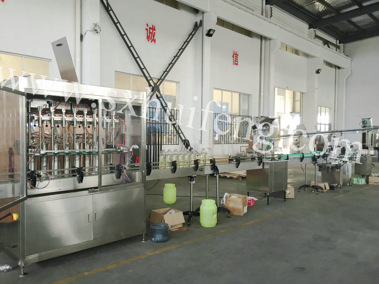 Automatic detergent bottle filling/cappin