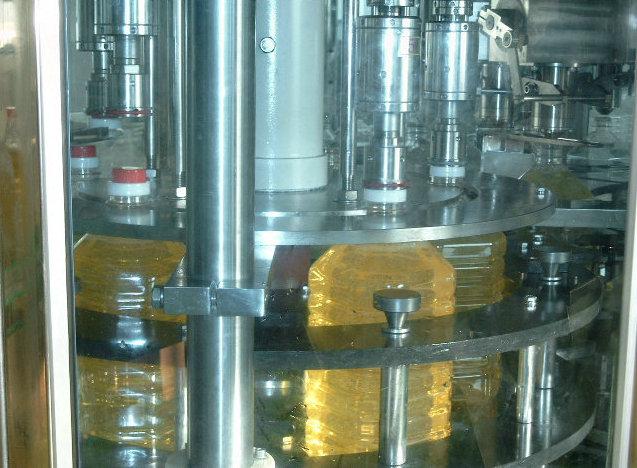 Oil filler and capper